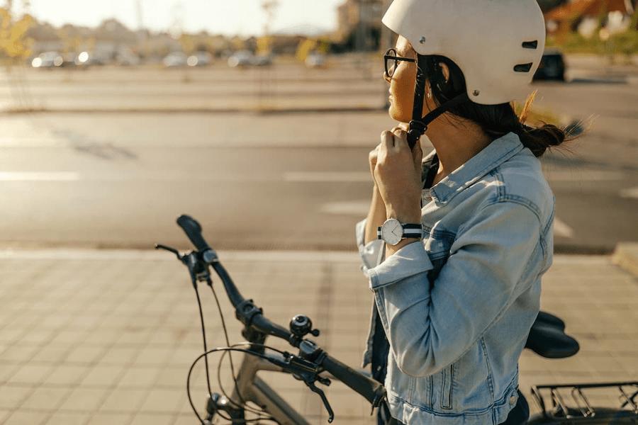 woman riding bike with helmet