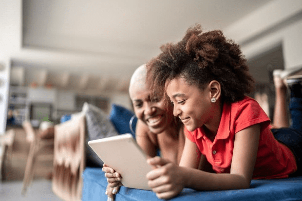 Mum and child looking at a tablet together